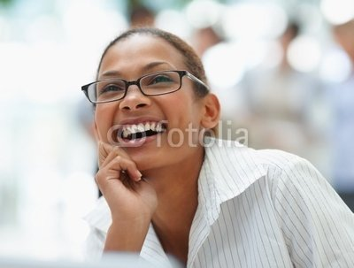 Young_business_woman_laughing_over_a_thought.jpg